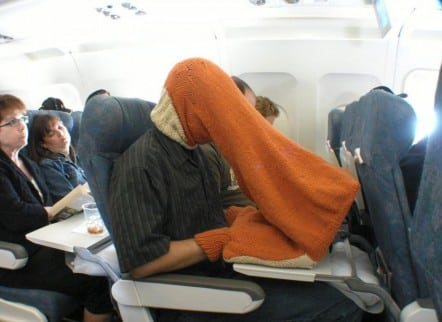 Watching porn on an airplane.