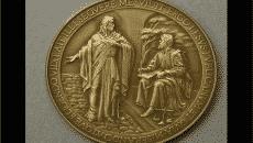 jesus mispelled on vatican medal