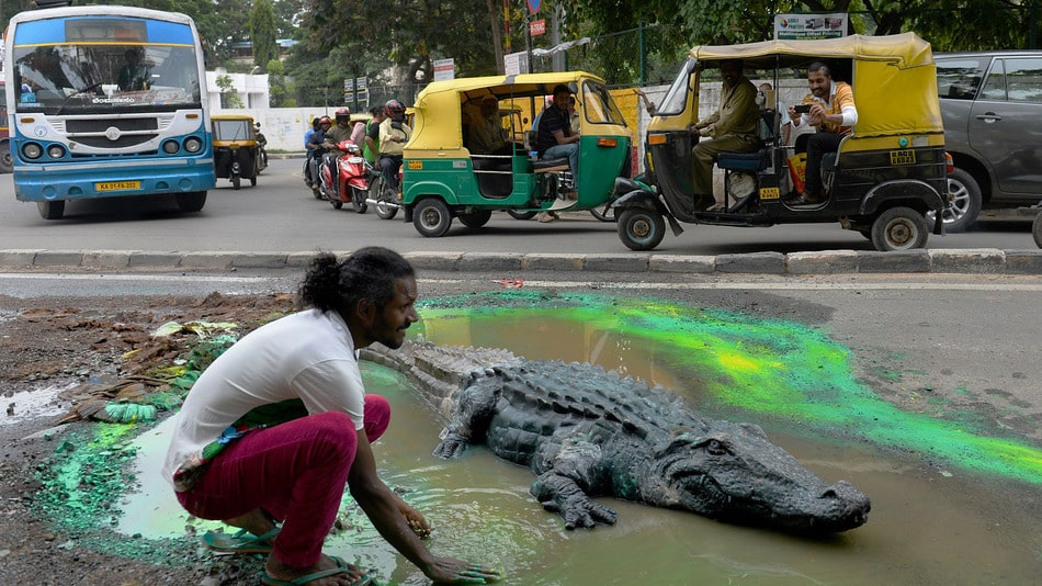 Featured image for Indian Artist Highlights Potholes with Crocs and More [Photos]