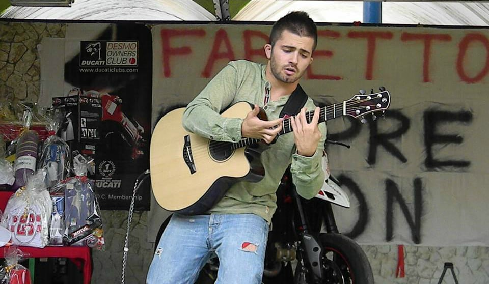 Luca Stricagnoli performs at a concert.