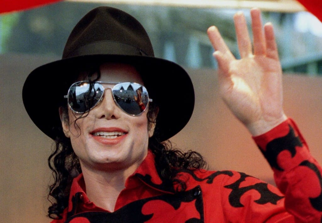 Michael Jackson waves to the crowd, numbering a few thousand, gathered in front of the Sydney Opera House in this November 17, 1996 file photo. Opening statements in civil trial over the death of Jackson begin April 29, 2013, with Katherine Jackson accusing concert promoters AEG Live of negligence in the hiring of convicted physician Dr. Conrad Murray. REUTERS/Megan Lewis/Files (AUSTRALIA - Tags: ENTERTAINMENT PROFILE OBITUARY)