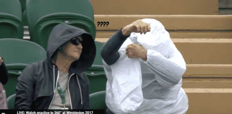 Featured image for Man At Wimbledon Can't Put on Poncho, Announcers Derive Joy From His Epic Struggle