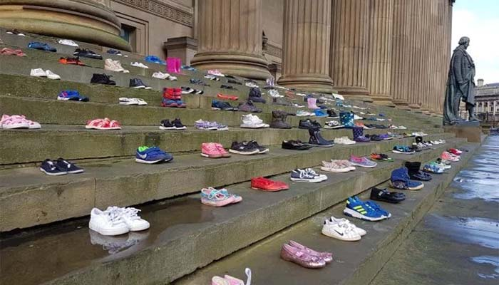 Charity Places 226 Pairs of Shoes on Steps to Commemorate Children Lost to Suicide
